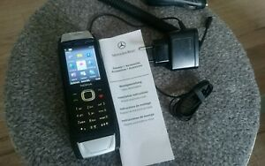 Nokia  Classic 6700 - Schwarz+ Aufnahmeschale für Mercedes