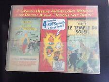 Valisette Tintin avec 4 pin's 2 cassettes VHS et 1 album jeu ETAT NEUF