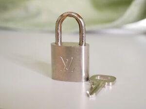 LOUIS VUITTON Silver Padlock & Key Set Silver number 300 Auth #3856P