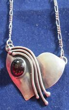 STERLING SILVER 14 INCH CHAIN WITH A MODERN HEART SHAPED PENDANT AND A GARNET