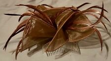 Brown mesh fabric hair comb accented with elegant brown feathers.
