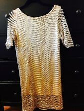 This is it with glitter and gold to get attention in any holiday party!