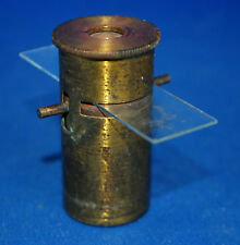An antique Victorian brass pocket microscope, with plain glass slide