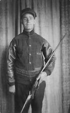 Real Photo Postcard Man Posing with Shot Gun Rifle and Belt of Bullets~114774