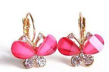 Chapado en oro rosa resina y cristal pendientes mariposa