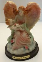 Megan's Collection Angle holding baby with flowers very colorful great condition