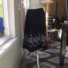 White Enbroidered Fliwers. 8 Allison Taylor Bkack Skirt With