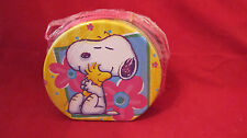 PEANUTS TIN IN SHAPE OF CIRCLE WITH CANVAS STRAP INCLUDES COOKIES