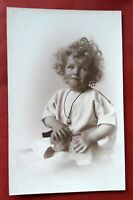 Vintage social history rp postcard of a little girl and her teddy bear