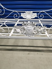 Antique wrought iron child's bed
