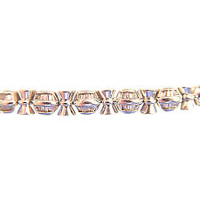 BAGUETTE SHAPE DIAMOND CHANNEL SET WITH GOLD BARS IN-BETWEEN DIAMOND