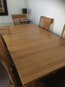 extending solid oak dining table and 6 chairs