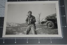 Korean War Man KNIFE IN MOUTH Rifle Gun @ Camera Military Truck Vintage PHOTO