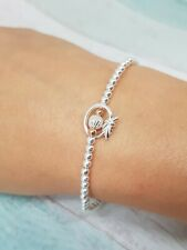 Sterling Silver Love Knot Stretch Bracelet with a hint of Rose Gold