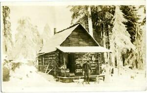 Log Cabin & Residents in the Snow ~MYRTLE POINT - OREGON~ RPPC / Postcard, 1913