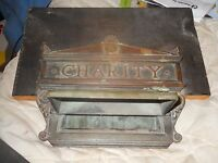 old BRASS OR COPPER  door plate  with the word CHARITY WITH A MAIL SLOT