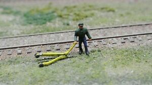 HO  scale worker with a floor jack