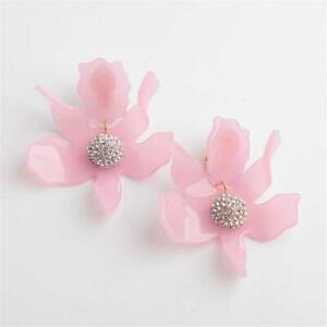 LeLe Sadoughi Crystal Lily Earrings Clip On Rose Hip