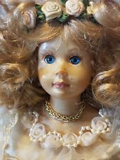 Porcelain Angel Doll Shelf Sitting Blonde Hair Blue Eyes Gold Dress Feather Wing