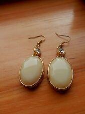 Rhine Stone Accent Pierced Earrings.New Oval Shape Warm Beige Color Bead