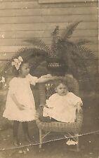 Cute Children and Wicker Chair RP Postcard