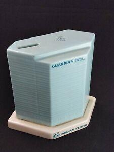 Guardian savings and loans building Ceramic Bank Coin 80's