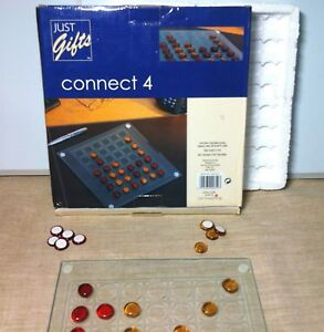 Connect 4 in a row Board Game. Glass counters and board. Paper backing missing