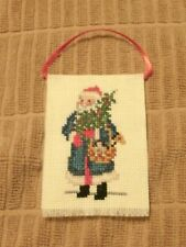 Finished completed cross stitch Christmas ornament - Victorian Santa with basket