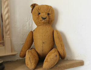 Antique European teddy bear. Cotter pin, straw filled limbs, shaved mohair body.