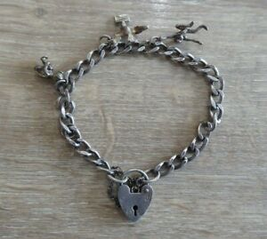 BEAUTIFUL VINTAGE SOLID SILVER CHARM BRACELET WITH 4 CHARMS