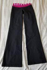 Lululemon size 4 blck groove Yoga Pant pink waist band