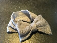 Grey knitted head warmer with bow