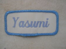 YASUMI USED EMBROIDERED  SEW ON NAME PATCH TAG LIGHT BLUE ON WHITE