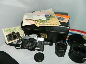 Minolta SRT100b film camera with 2 lenses, bag and papers - purchased in 1976