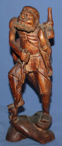 Vintage hand carved wood Asian old man statuette