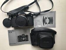Rolleiflex SL35 nera con Planar 50mm. f1.8 e accessori
