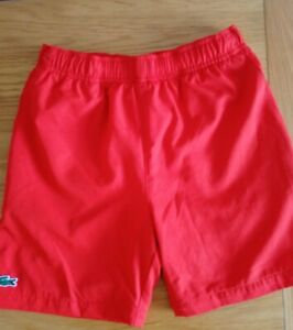"Boys Lacoste Sports Shorts . Shell Aged 10, 56 "" 140 cm. Orange. Excellent cond."