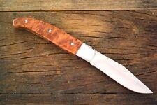 Das Lauburu in Thuja, das Messer der Basken        laguiole