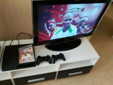 Console Sony PS3 Slim 160 GB HDMI noir plus une manette et le jeu top spin 4