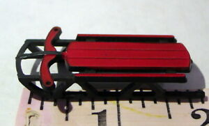 Vintage plastic sled use as ornament or prop