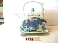 blue flower on white with tray tea pot