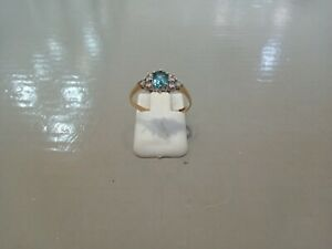 9 carat yellow and white gold Blue Topaz and Cubic Zirconia ring size J.