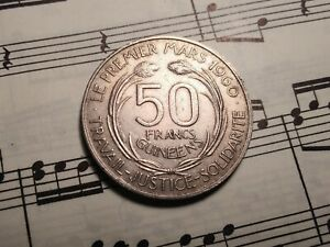 GUINEA 50 Francs 1969 KM8 Cu-Ni 1-year type ABOVE AVERAGE most melted VERY RARE!