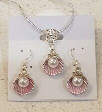 Imitation pearl in a shell stirling silver necklace and earring set.