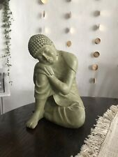 Buddha Leaning on Knee Statue