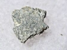 .059 grams NWA 2724 Meteorite ( class Eucrite ) cut fragment NorthWest Africa