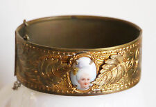 Antique Victorian brass hinged bangle w/leaves, glass litho cameo, safety chain