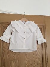 White frilled baby girl shirt from River a Island. 6-9 months.