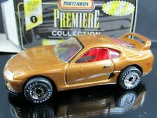 "SCRATCHES ON HOOD"" GOLD TOYOTA SUPRA PREMIERE SER.1 LOOSE MATCHBOX DIECAST CAR"