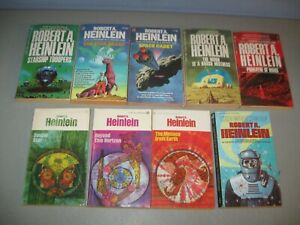 Lot of 9 Robert A. Heinlein Sci-Fi vintage paperback assorted books)*